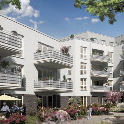 Außenansicht Mehrfamilienhaus mit Balkonen und Innenhof