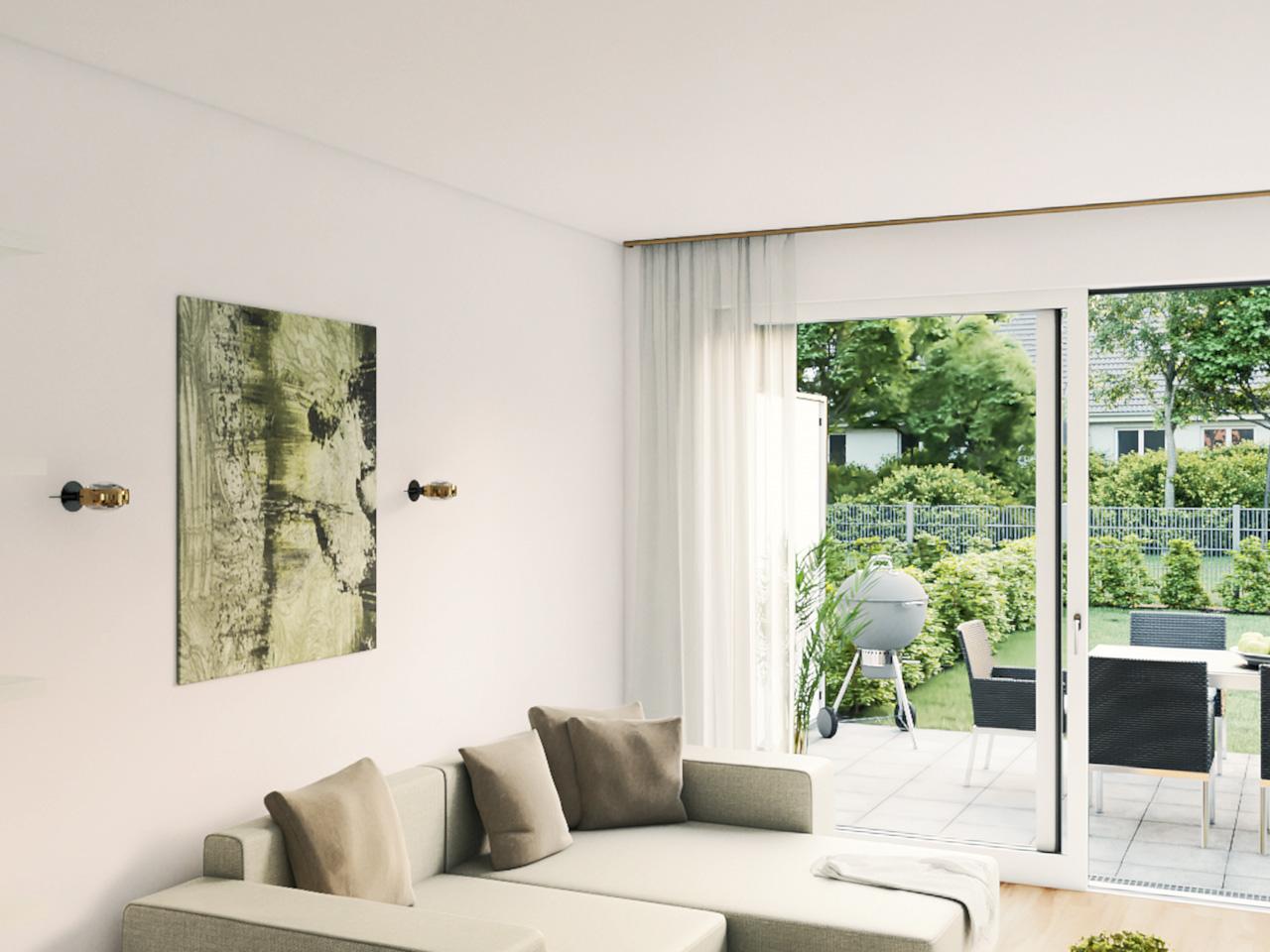 Blick in ein Wohnzimmer mit Aussicht auf Terrasse und Garten